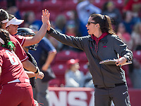 NWA Democrat-Gazette/BEN GOFF @NWABENGOFF<br /> Courtney Diefel, Arkansas head coach, high-fives players after the top of the 5th inning vs South Carolina Sunday, March 17, 2019, at Bogle Park in Fayetteville.