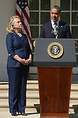 United States President Barack Obama (R) delivers remarks beside US Secretary of State Hillary Clinton (L) on the killing of US ambassador to Libya, Christopher Stevens, and three embassy staff, in the Rose Garden of the White House in Washington DC, USA, 12 September 2012. Gunmen attacked the US consulate in Benghazi, killing Stevens and three others, late 11 September 2012, while another assault took place on the US embassy in Cairo..Credit: Michael Reynolds / Pool via CNP