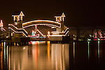 The worlds longest floating boardwalk illuminated with holiday light display. Coeur 'd Alene, Idaho.