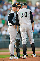 Kane County pitching coach Don Schultze has a chat with his starting pitcher, John Herrera (30), during their game versus Dayton at Fifth Third Field in Dayton, OH, Monday, May 7, 2007.