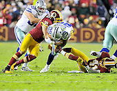 Dallas Cowboys running back DeMarco Murray (29) is tackled by Washington Redskins linebacker Ryan Kerrigan (91) and safety Madeu Williams after a 5 yard gain to start the fourth quarter at FedEx Field in Landover, Maryland on Sunday, December 30, 2012.  Cowboys tackle Doug Free (68) tries to block Kerrigan.  The Redskins won the game 28 - 18 to capture the NFC East title..Credit: Ron Sachs / CNP.(RESTRICTION: NO New York or New Jersey Newspapers or newspapers within a 75 mile radius of New York City)