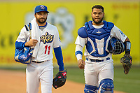 Rancho Cucamonga Quakes starting pitcher Jordan Sheffield (11) and catcher Hamlet Marte (50) walk to the dugout prior to the game against the Inland Empire 66ers at LoanMart Field on April 12, 2018 in Rancho Cucamonga, California. The 66ers defeated the Quakes 5-4.  (Donn Parris/Four Seam Images)