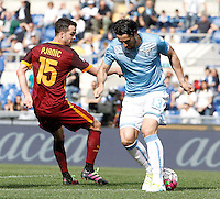 Calcio, Serie A: Lazio vs Roma. Roma, stadio Olimpico, 3 aprile 2016.<br /> Lazio's Milan Bisevac, right, is challenged by Roma's Miralem Pjanic during the Italian Serie A football match between Lazio and Roma at Rome's Olympic stadium, 3 April 2016.<br /> UPDATE IMAGES PRESS/Isabella Bonotto