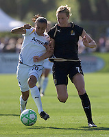 Marta (10) and Leigh Ann Robinson (7) battle for control of the ball. Los Angeles Sol defeated FC Gold Pride 2-0 at Buck Shaw Stadium in Santa Clara, California on May 24, 2009.