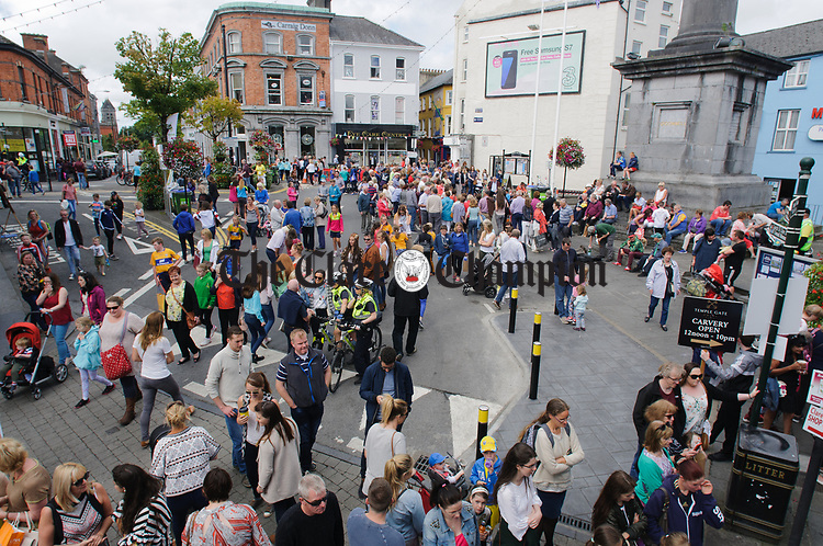 The crowd gathers on O Connell street to listen to buskers and sample the atmosphere during Fleadh Cheoil na hEireann in Ennis. Photograph by John Kelly.
