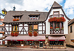 Colorful half-timbered building with shops in Obernai