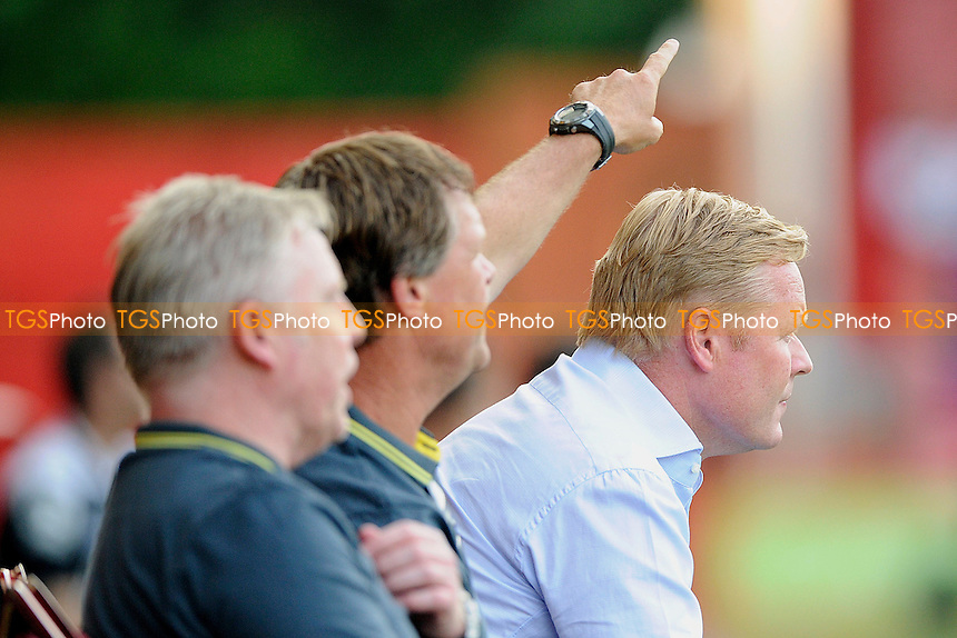 The Southampton bench shout instructions as sammy lee and Southampton Manager Ronald Koeman look on - AFC Bournemouth vs Southampton - Pre-Season Friendly Football Match at the Goldsands Stadium, Kings Park, Boscombe, Bournemouth, Dorset - 25/07/14 - MANDATORY CREDIT: Denis Murphy/TGSPHOTO - Self billing applies where appropriate - contact@tgsphoto.co.uk - NO UNPAID USE