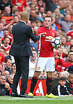 Josep Guardiola manager of Manchester City clashes with Wayne Rooney of Manchester United over the ball during the Premier League match at Old Trafford Stadium, Manchester. Picture date: September 10th, 2016. Pic Simon Bellis/Sportimage