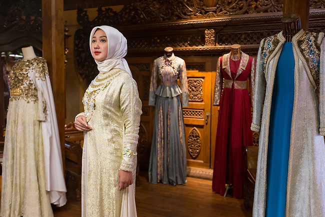 23 JAN, 2018, Jakarta, Indonesia: Indonesian fashion designer and icon, Dian Pelangi (27)showing off one of her detailed gowns at her workshop and retail outlet in the suburb of Kemang. She is discussing the rise of Islamic fashion and the massive revenue boost the sector is bringing to the Indonesian economy and individual designers and industry as a whole. Pictured in Jakarta by Graham Crouch for Luzerner Zeitung