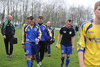 VOETBAL: DRONRIJP: 06-04-2014, Sportcomplex Schatzenburg, VV Dronrijp - SC Franeker, uitslag 2- 2, teleurstelling bij de spelers van SC Franeker na afloop van de wedstrijd, ©foto Martin de Jong