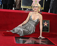 HOLLYWOOD, CA - JANUARY 8: Gillian Anderson receives a star on the Hollywood Walk of Fame in Hollywood, California. January 8, 2018. <br /> CAP/MPI/FS<br /> &copy;FS/MPI/Capital Pictures
