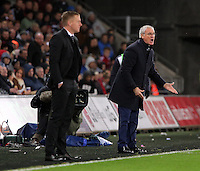 (L-R) Swansea manager Garry Monk and Leicester manager Claudio Ranieri during the Barclays Premier League match between Swansea City and Leicester City at the Liberty Stadium, Swansea on December 05 2015