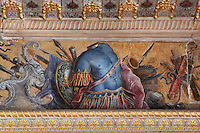 Frieze with armour, shields, spears and weapons at the top of the walls of the Guard Room, attributed to Ruggerio de Ruggieri, c. 1570, rearanged in Louis XIII's day, Chateau de Fontainebleau, France. The Palace of Fontainebleau is one of the largest French royal palaces and was begun in the early 16th century for Francois I. It was listed as a UNESCO World Heritage Site in 1981. Picture by Manuel Cohen