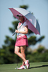 Paula Creamer of USA shelters from the sun under an umbrella on the 6th hole during the day one of the Sunrise LPGA Taiwan Championship at the Sunrise Golf Course on October 25, 2012 in Taoyuan, Taiwan. Photo by Victor Fraile / The Power of Sport Images
