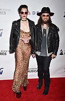 LOS ANGELES, CA - FEBRUARY 08: Lzzy Hale (L) and Joe Hottinger of Haelstorm, attend MusiCares Person of the Year honoring Dolly Parton at Los Angeles Convention Center on February 8, 2019 in Los Angeles, California.<br /> CAP/ROT/TM<br /> &copy;TM/ROT/Capital Pictures