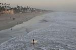 Surfer near Oceanside pier