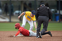 Matt Rudick (9) of the San Diego State Aztecs slides into second base ahead of the tag from Hogan Windish (18) of the UNCG Spartans as umpire David Brown looks on at Springs Brooks Stadium on February 16, 2020 in Conway, South Carolina. The Spartans defeated the Aztecs 11-4.  (Brian Westerholt/Four Seam Images)