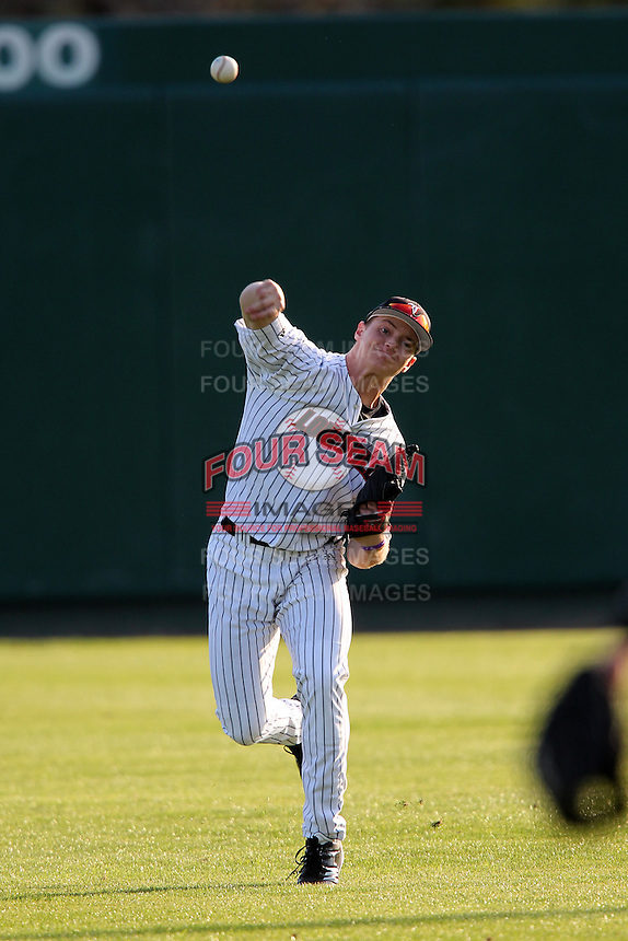 Outfielder Adam Engel #10 of the Louisville Cardinals during the Big East-Big Ten Challenge vs. the Michigan Wolverines at Al Lang Field in St. Petersburg, Florida;  February 18, 2011.  Louisville defeated Michigan 6-3.  Photo By Mike Janes/Four Seam Images