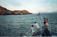 Divers enjoy their first glimpse of Isla Delfonzo in the southern part of the Sea of Cortez