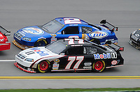 Oct. 30, 2009; Talladega, AL, USA; NASCAR Sprint Cup Series driver Sam Hornish Jr (77) races alongside teammate Kurt Busch (2) during practice for the Amp Energy 500 at the Talladega Superspeedway. Mandatory Credit: Mark J. Rebilas-