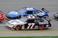 Oct. 30, 2009; Talladega, AL, USA; NASCAR Sprint Cup Series driver Sam Hornish Jr (77) races alongside teammate Kurt Busch (2) during practice for the Amp Energy 500 at the Talladega Superspeedway. Mandatory Credit: Mark J. Rebilas-