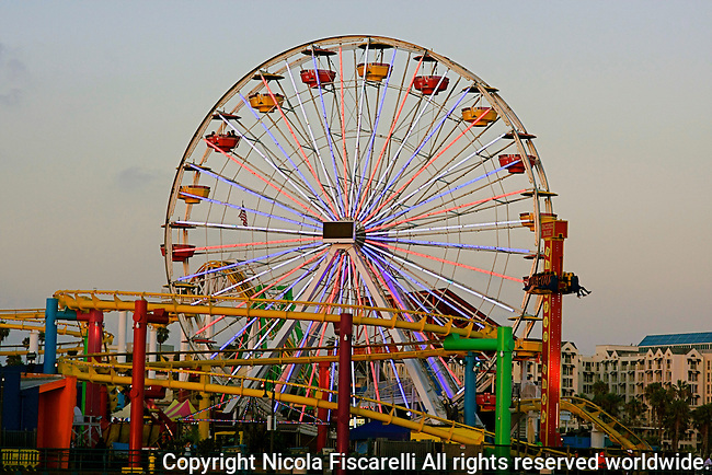 An early  evening view of the  ferris wheel in Santa Monica Pier,California.