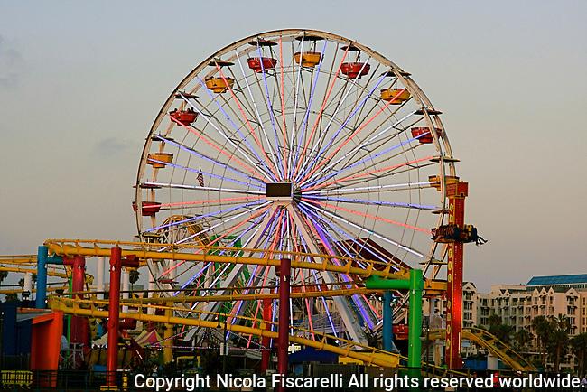 An early  evening view of the  ferris wheel in Santa Monica Pier,California.