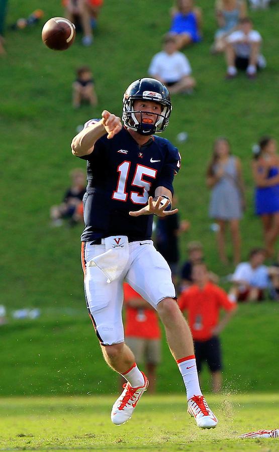 Virginia quarterback Matt Johns (15) throws the ball during the game Saturday Sept. 6, 2014 at Scott Stadium in Charlottesville, VA. Virginia defeated Richmond 45-13. Photo/Andrew Shurtleff