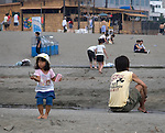 Girl playing on the beach at Kamakura, Tokyo, Japan. Editorial Only.