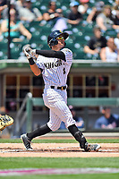 Charlotte Knights left fielder Jacob May (8) swings at a pitch during a game against the  Gwinnett Braves at BB&T Ballpark on May 7, 2017 in Charlotte, North Carolina. The Knights defeated the Braves 7-1. (Tony Farlow/Four Seam Images)