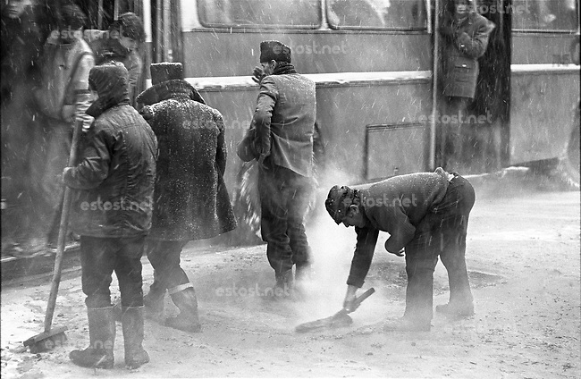 ROMANIA, 6 Martie Bd., Bucharest, 29.04.1984.Hot asphalt is shovelled unto snow - Ceausescu will pass this way tomorrow, on Republic Day..© Andrei Pandele / EST&OST