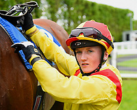Holly Doyle unsaddles Sans Souci after winning The Priority Mailing & Digital Print Claiming Stakes, during Afternoon Racing at Salisbury Racecourse on 18th May 2017
