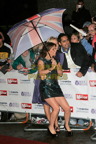 EMMA BUNTON & GERI HALLIWELL.The Pride of Britain Awards, London Television Centre, South Bank, London, England, UK, .September 30th, 2008 .full length union jack umbrella spice girls raining blue long sleeved dress striped clutch bag green print black shoes sandals floral baby ginger posing with fans crowd .CAP/AH.©Adam Houghton/Capital Pictures.