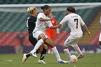 Rachel YANKEY of Great Britain tangles with Katie HOYLE of New Zealand - Great Britain Women vs New Zealand Women - Womens Olympic Football Tournament London 2012 Group E at the Millenium Stadium, Cardiff, Wales - 25/07/12 - MANDATORY CREDIT: Gavin Ellis/SHEKICKS/TGSPHOTO - Self billing applies where appropriate - 0845 094 6026 - contact@tgsphoto.co.uk - NO UNPAID USE.