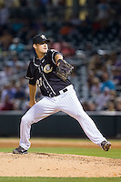 Charlotte Knights relief pitcher Taylor Thompson (27) in action against the Scranton/Wilkes-Barre RailRiders at BB&T Ballpark on July 17, 2014 in Charlotte, North Carolina.  The Knights defeated the RailRiders 9-5.  (Brian Westerholt/Four Seam Images)