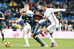 Real Madrid's Toni Kroos (l) and Raphael Varane (r) and Real Sociedad's Juanmi Jimenez during La Liga match. January 29,2017. (ALTERPHOTOS/Acero)