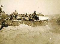 BNPS.co.uk (01202 558833)<br /> Pic: RNLI<br /> <br /> Launch of Hastings lifeboat 'Cyril and Lilian Bishop'<br /> <br /> Splash in the Attic...<br /> <br /> A 'lost' cache of 13,000 photographs charting the history of the RNLI has been found in the attic of the charity's headquarters.<br /> <br /> Many of the black and white photos date back to the 1920s and '30s long before the terms 'health and safety' and 'risk assessment' were thought of.<br /> <br /> One image depicts a brave lifeboatman dressed in a suit and cloth cap just as the lifeboat he is on launches down a ramp into a choppy sea.<br /> <br /> Another shows the crew of another open lifeboat getting swamped by waves with only their souwesters and lifejackets to protect them.<br /> <br /> The photos have been unearthed in storage space at the RNLI HQ in Poole, Dorset, and they are now being digitised.