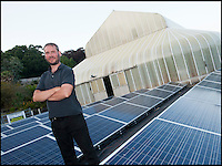 BNPS.co.uk (01202 558833)<br /> Pic: PeterWillows/BNPS<br /> <br /> Botanist Chris Kidd with the special photo voltaic cells brought in to boost the temperatures in the hot house.<br /> <br /> A botanical marvel bloomed at the Ventnor Botanical  Garden on the Isle of Wight this weekend and gardener Hannah Rogers(17) had to bravely don her swimsuit and keep an all night vigil to capture it.<br /> <br /> The giant Amazonian lily flowers for only two night a year and plucky Hannah had to plunge into the pool to remove pollen from Victoria cruziana on its first flowering to replicate the process performed by a nocturnal scarab beetle attracted to its heavy pineapple like scent in the wild.<br /> <br /> The amazing plant first blooms in white on the first night, then changes sex and flowers the following night a deep red before sinking back under the water.<br /> <br /> VBG are attempting to hybridise the two different plants they have (V.cruziana and V. amazonica) and then produce a brand new species that will be the largest lily in the world.<br /> <br /> These massive plants have grown at an extraordinary speed in only 3 months from a seed the size of a pea carefully planted in 2 tonnes of donkey manure in a 8ft square pots. <br /> <br /> The highly controlled hot house, where the specially filtered water is kept at 26C, the air at 45C and 90per cent humidity, is powered by its own array of photovoltaic cells.
