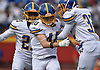 Peter Taliercio #40 of Kellenberg, center, gets congratulated by teammates Matthew Leahy #32, right, and Alain Telfort #21 after making an interception in the first quarter of an NSCHSAA varsity football game against host Chaminade High School in Mineola on Sunday, Oct. 14, 2018. Kellenberg held Chaminade scoreless for three quarters (28-0) and won by a final score of 42-14.
