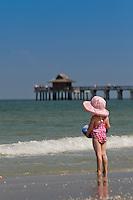 Young girl plays on Naples Beach at historic Naples Fishing Pier, Naples, Florida, USA. Photo by Debi Pittman Wilkey