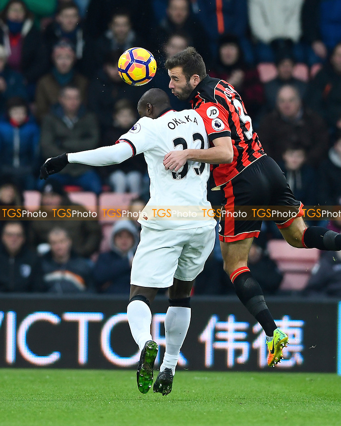 Steve Cook of AFC Bournemouth right wins a header from Stefano Okaka Chuka of Watford during AFC Bournemouth vs Watford, Premier League Football at the Vitality Stadium on 21st January 2017