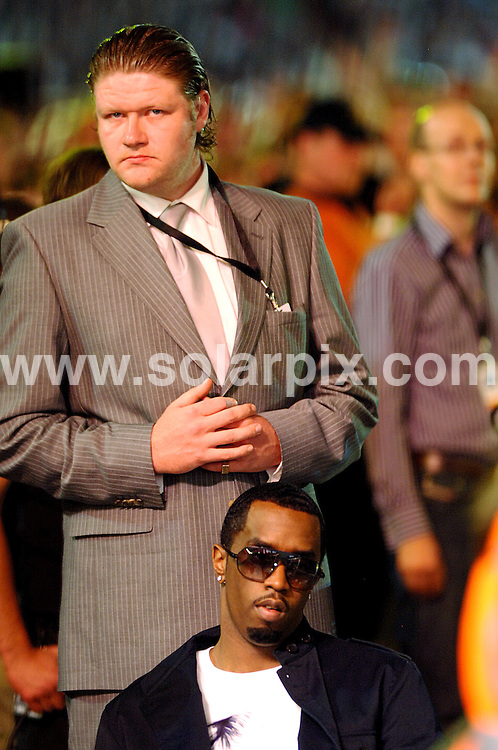 **ALL ROUND PICTURES FROM SOLARPIX.COM**.**WORLDWIDE SYNDICATION RIGHTS**.The Princess Diana Memorial concert at wembley stadium...This pic: P Diddy AKA Puff Daddy AKA Sean 'Puffy' Coombs watches the concert backstage with his minder keeping a watchful eye..JOB REF:  4202-STN        DATE: 03_07_2007.**MUST CREDIT SOLARPIX.COM OR DOUBLE FEE WILL BE CHARGED* *UNDER NO CIRCUMSTANCES IS THIS IMAGE TO BE REPRODUCED FOR ANY ONLINE EDITION WITHOUT PRIOR PERMISSION*