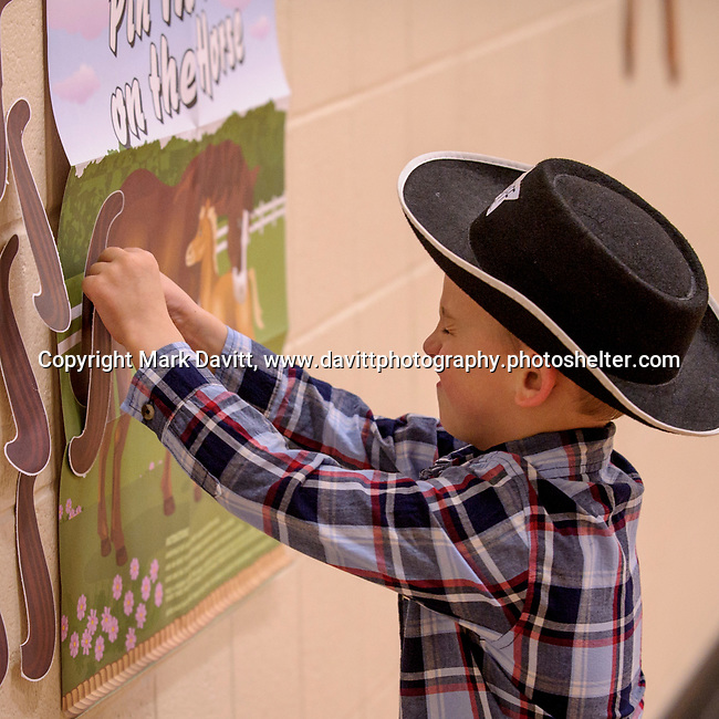 Bondurant hosted a Mother and Son Hoedown March 25 at Anderson Elementary. Everyone had a rootin' tooting' time with lots of snacks, games, crafts, music and dancing too. Zac Lenaghan played pin the tail on the horse.
