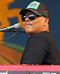 NEW ORLEANS, LA - MAY 03: Musician Ivan Neville performs during the 2012 New Orleans Jazz & Heritage Festival at the Fair Grounds Race Course on May 3, 2012 in New Orleans, Louisiana.