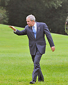 Washington, D.C. - September 12, 2008 -- United States President George W. Bush waves to well wishers as he walks across the South Lawn of the White House after arriving aboard Marine 1 on Friday, September 12, 2008.  The President is returning from events in Oklahoma City, Oklahoma. <br /> Credit: Ron Sachs / Pool via CNP