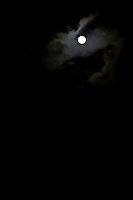 Full moon with dark clouds