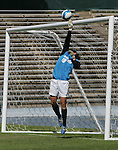 Virginia Tech's Ashley Owens tips a shot by North Carolina's Yael Averbuch (not pictured) off the crossbar at the end of the first half on Sunday, October 15th, 2006 at Fetzer Field in Chapel Hill, North Carolina. The University of North Carolina Tarheels defeated the Virginia Tech Hokies 1-0 in an Atlantic Coast Conference NCAA Division I Women's Soccer game.