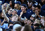 Nevada students take photos while waiting to run across the field before an NCAA college football game against UC Davis in Reno, Nev. on Thursday, Sept. 3, 2015. (AP Photo/Cathleen Allison)
