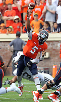 Virginia quarterback David Watford (5) gets pressure from Brigham Young linebacker Kyle Van Noy (3) during the first half of the game in Charlottesville, Va. Virginia defeated Brigham Young 19-16. Photo/Andrew Shurtleff