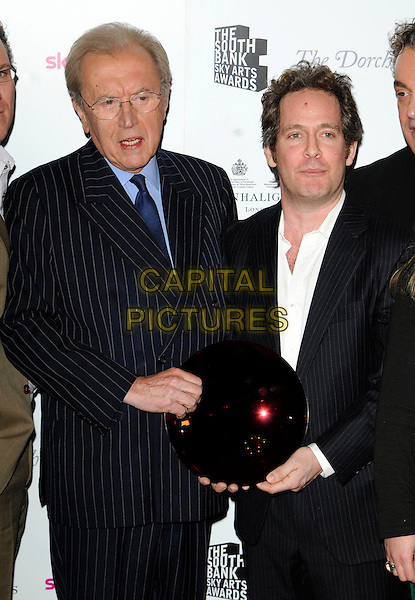 SIR DAVID FROST & TOM HOLLANDER.The South Bank Sky Arts Awards, The Dorchester Hotel, London, England, UK, 25th January 2011..half length black suit jacket white shirt glasses award trophy winner.CAP/CAN.©Can Nguyen/Capital Pictures.